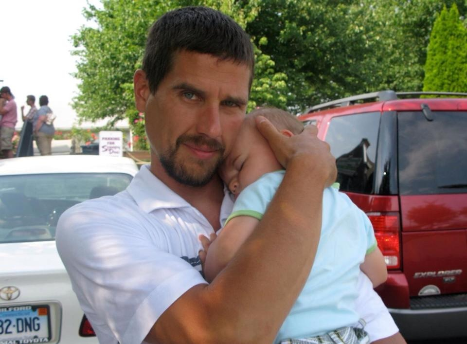 Matt Miller holds his infant son Holden, who is now 7. Matt was killed last month when his bicycle was struck by a car.