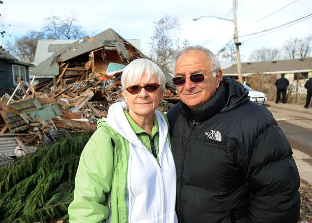 Sheila and Dominic Traina near their home that was destroyed by Superstorm Sandy during the fall. (Photo by The Daily News.)